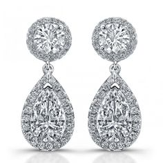 Are you looking for a charming set of earrings for some special occasions? These hand-crafted platinum drop earrings by Uneek Jewelry feature 3.44 ct. tw. pear shape diamonds wrapped in a halo of round diamonds, suspended from 1.28 ct. tw. round diamonds also wrapped in halos of micropave diamonds. www.diamonds.pro