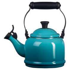 A colorful addition to your stovetop, this lovely tea kettle pairs enameled stoneware with a Caribbean finish.   Product: Tea ke...