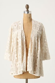 Cream color with a vintage look. Looks good with a tank and denim shorts or a romantic dress.