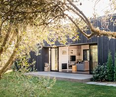 This small secondary dwelling on a Hawke's Bay lifestyle block was designed to accommodate extended family but has found new purpose as an Airbnb Tree Wallpaper Nursery, Surf Lodge, Little Cottages, Celtic Tree Of Life, Inside Home, Polished Concrete, Olive Tree, House Floor Plans, Exterior Design