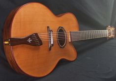 Buscarino 7-string Oval-hole Virtuoso Archtop- Pre-Owned | Reverb