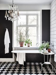 Black walls: it seems like people either love them or hate them. A black walled interior is certainly a bold design choice and not for everyone. Black walls command attention in the most dramatic of ways. They absorb a lot of natural light, so beRead Black White Bathrooms, White Rooms, Bathroom Black, Master Bathroom, Bathroom Yellow, Bathroom Vintage, Black And White Bathroom Ideas, Black Bathtub, Black Tub