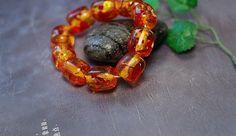 Amber colored resin large barrel beads mala bracelet | shangrilacraft - Jewelry on ArtFire   http://www.artfire.com/ext/shop/product_view/9659806