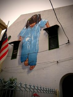 Five Recent Pieces Of Cool Interactive Street Art; this by Ernest Zacharevic in Penang, Malaysia