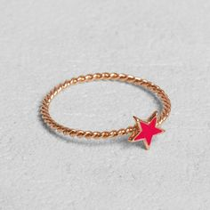 Petit Sesame | Rose gold-plated pink babystar ring | Designed by Petit sesame | $12.00 | Rose gold plated full brass ring adorned with a pink star