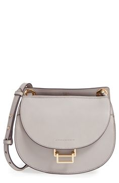 Sleek equestrian-inspired curves refine this classic crossbody bag with polished goldtone hardware.