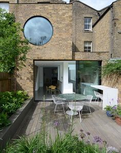Jimi House by Paul Archer Design features round window inspired by abstract art. Victorian Terrace, Victorian Homes, Exterior Design, Interior And Exterior, Cafe Exterior, Garage Design, Modern Exterior, London House, House Extensions