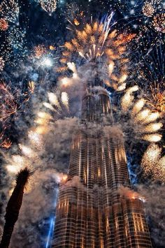 New Year's Eve Fireworks from the Burj Khalifa in Dubai, United Arab Emirates. Burj Khalifa was named in honor of the ruler of Abu Dhabi and president of the United Arab Emirates, Khalifa bin Zayed Al Nahyan. The building broke numerous height records. Silvester Trip, Beautiful World, Beautiful Places, Amazing Places, Amazing Photos, Fireworks Photography, Travel Photography, Fire Works, Burj Khalifa