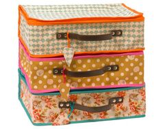 fabric suitcases with leather handle. the link is old, so I don't think these are available for sale at the original site.