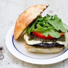 This portobello burger with homemade pesto is sure to blow your mind. Toss one on the grill tonight!