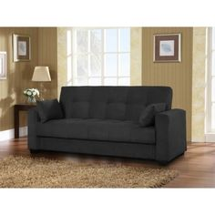 Lexington Sofa @ Target.  Temporarily $399.99 wth free shipping.  Converts to a bed.  Made with real wood.  :-)