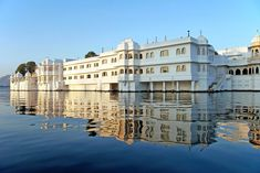 Built on a four acre island on Lake Pichola in Udaipur, India, is the Taj Lake Palace resort. Honestly, magnificent, right?! Each of the 83 suites in the 263 year old former palace epitomizes royal grandeur with opulent silks, antique furniture, vibrant frescoes, mosaics and views of the
