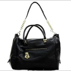 """Steve Madden Black Handbag Gently used with light wearing on the metal (as shown in picture 4). One inside zipped pocket with two pen pockets and one zipper outside pocket. 7"""" Short strap and 15"""" long strap. 16"""" L x 5"""" D x 11.5"""" H. No trades for this item. Price is firm. Steve Madden Bags"""
