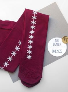 Young+British+Designers:+Plum+Snowflake+Hand-Printed+Tights+by+hose.+-+New+season+flirtatiousness+for+legs.+Repeat+snowflakes+accentuate+your+legs+and+make+for+a+fresh+take+on+plain+opaque.