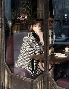 For days people in the 20th asked about the girl wearing the checkered coat in the window of Le Chantefable. On her, Christian Dior coat ($4,500); stylist's own earrings. On him, Dior Homme suit ($3,500), shirt ($580), and tie ($190); Gucci sunglasses ($450).