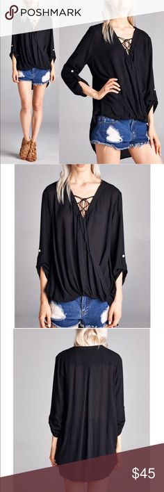 LARA lace up front loose fit blouse - BLACK WRAP FRONT WITH LACE UP DETAIL, 3/4 ROLL TAB SLEEVE HIGH LOW LOOSE FIT SOLID SHIRT Fabric 100% rayon  NO TRADE, PRICE FIRM Bellanblue Tops Blouses