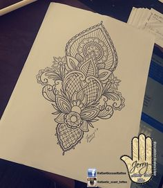 Beautiful tattoo idea design for a thigh arm by dzeraldas jerry kudrevicius from Atlantic Coast tattoo.  Mandala lotus lace tattoo design with pretty patterns. Design ornamental drawing tattoo idea