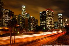 The Harbor Freeway, Highway 110, passes through downtown with the Los Angeles  city skyline in the background, California