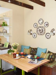 Artwork for Walls:  Symmetrical Arrangement  Create a picture-perfect plate arrangement on your walls with a little bit of prep work. Trace the items you plan to hang onto paper. Cut out the shapes and tape to the wall in different arrangements until you get the perfect combination.