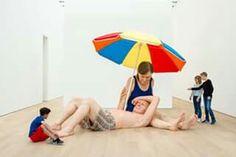Couple under an umbrella   Ron Mueck