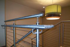 Our cable railing systems give your stairs a distinct modern touch. Expertly installed, they lend a unique beauty to your stairs. Cable Railing Systems, Newel Posts, Wood And Metal, Contemporary, Modern, Interior And Exterior, Track Lighting, Stairs, Ceiling Lights