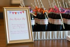 Baby shower party favor idea - glass bottles of pop with a fun straw tied on!
