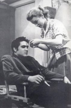 Delores Hart messing with Elvis' hair. She is know known as Mother Dolores of the Abbey of Regina Laudis