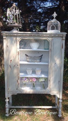 Milk painted china cabinet with chicken wire and metallic paint. love