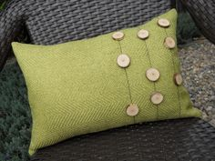 green outdoor pillow with buttons