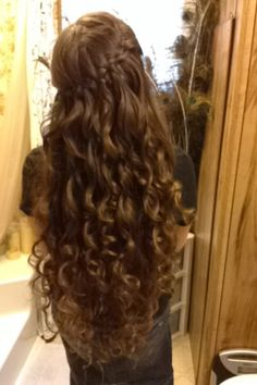 Look what my mom did to my hair for church today! It is awesome!! It's a Waterfall braid!!