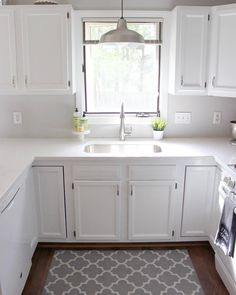 (@the_walker_residence)  Wall color Stonington Gray by Benjamin Moore. American Standard Faucet. Sherwin Williams trim and door paint used for cabinets. Stainless steel single bowl undermount sink. Quartz counters in Mysterio.