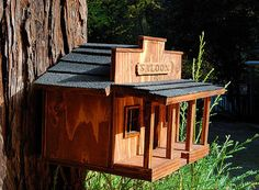 Beautiful handcrafted western themed birdhouse. Great for outdoors as a functional dwelling or indoors as a decoration. Highly detailed with window trim and real roof shingles. Saloon signage is woodburned by hand. Hinged door on rear allows for easy cleaning or adding a bowl of
