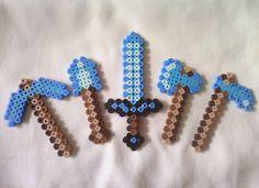Perler Minecraft Diamond Tool Set. $8.00, via Etsy. but w\ enchantments i'll show what it looks like later :P