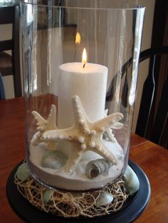 Create a seaside themed centrepiece using seashells and starfish