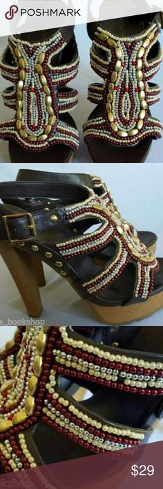 """BCBGeneration Brown Beaded Platform Sandals Sz 7 5"""" wooden heels and brown beaded Barcelona platform shoes from BCBGeneration are a sophisticated and sexy addition to your wardrobe. All man made materials. One small bead missing as seen in photos. Otherwise very good pre-owned condition. BCBGeneration Shoes Platforms"""