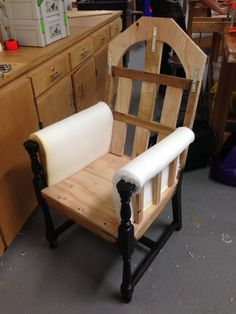 Upholstery begins. Cutting and shaping the foam around the arms.