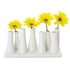 Torre & Tagus Eva Multi Tube Vase Wide Rectangle, White by Torre & Tagus. $25.00. Contemporary and unique. Nature inspired design. White ceramic multi tube vase. Torre & Tagus Eva Multi Tube Vase White Narrow Rectangle. This contemporary ceramic multi tube bud vase allows you to create a unique arrangement with ease.
