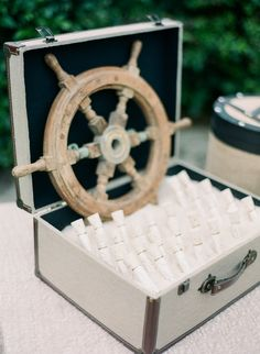"Nautical ""message in a bottle"" escort cards"