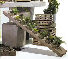 """Add a vintage touch to your outdoor space or porch with this 16 pot vertical garden. A unique way to show off your favorite plants! Dimensions: 10""""W x 56""""L"""