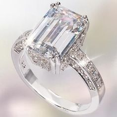 This ring is absolutely gorgeous! STACY loves Emerald Cut Diamond rings for possible wedding ring.
