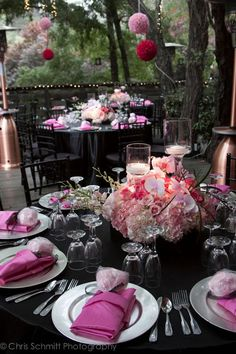 Black table linens give a high-fashion feel to a pink wedding color scheme. Wedding coordination by Bella Vita Events.