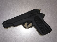 Gun cookies - My 13-yr-old daughter made these for a birthday party. I printed out a picture of a gun, traced it onto card stock and then cut it out. She used the template and hand cut all the cookies. Baking & decorating all done by her.