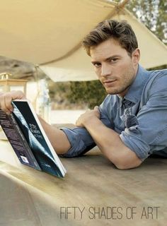 Jamie reading 50 shades. he better learn his part!