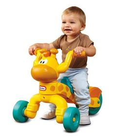 Little Tikes Go and Grow Lil' Rollin' Giraffe Ride-on. Make sure this fits by entering your model number. Friendly giraffe ride-on and scoot toy with adjustable seat. The over-sized back wheel provides added stability and includes a wheel guard for safety Toddler Bike, Toddler Toys, Baby Toys, Kids Toys, Toddler Gifts, Toddler Activities, Minnie Mouse, Giraffe Toy, Baby Bike