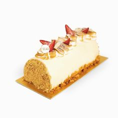 """""""FLEUR DE NEIGE"""" (Soft Cheesecake Log.)  Cheesecake sponge, cream cheese mousse, white chocolate glaze, torched Swiss meringue, red berries, candied cashews, sliced almonds."""