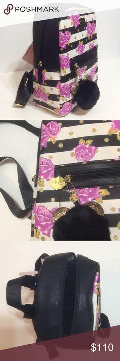 🆕   ⭐️ On Sale!  Betsey Johnson medium backpack Sooo cute, a statement! full of fun details this bag is very spacious and light, easy to wear on one side or as a regular backpack, cool use of fabric black n white contrasting the pink and gold 😍 great for every day and for travel.  Measures 13 inches in height,  10 inches wide and 4.5 inches in depth, perfect medium size as it is not too small or too big, new with tag, never used Betsey Johnson Bags