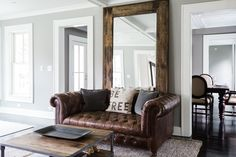 Mirror behind sofa ???? open up the room ...we need a mirror somewhere....can't decide where....