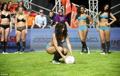 Under pressure: Another players places the ball down on the spot during the 4-a-side compe...