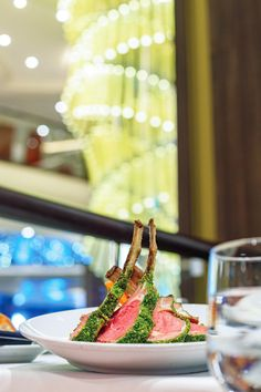 Royal Caribbean Cruise Dining | An exceptional affair featuring extraordinary personal service from your dedicated wait staff and a new menu each evening, the Main Dining Room is certain to surprise even the most sophisticated of palates.