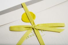 Letterpress Wedding Invites. Classic and simple, whites and grays with green, wax seal and tied with a ribbon.